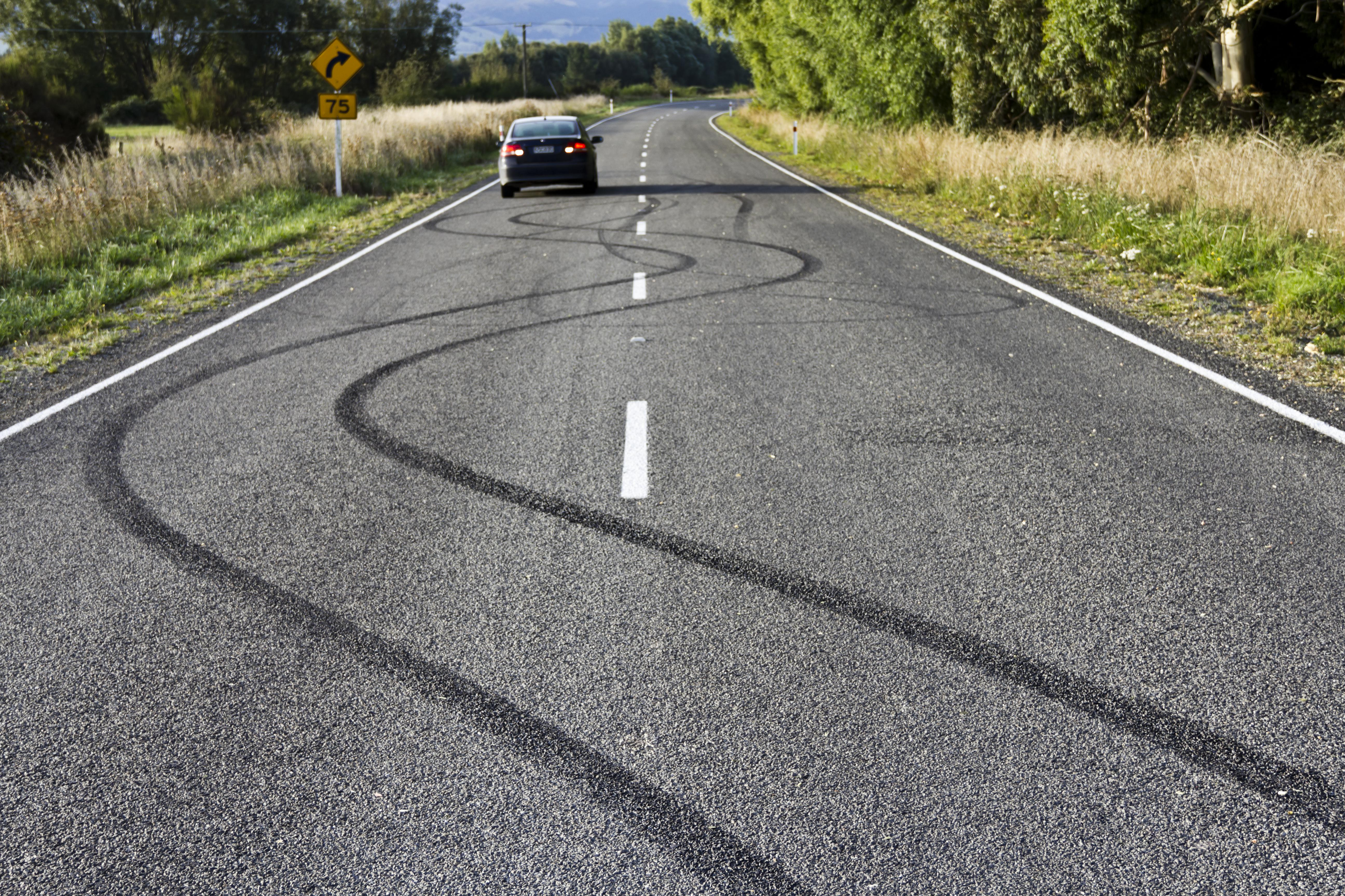 Skidmarks on country road
