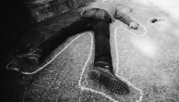 Dead man on ground, b&w