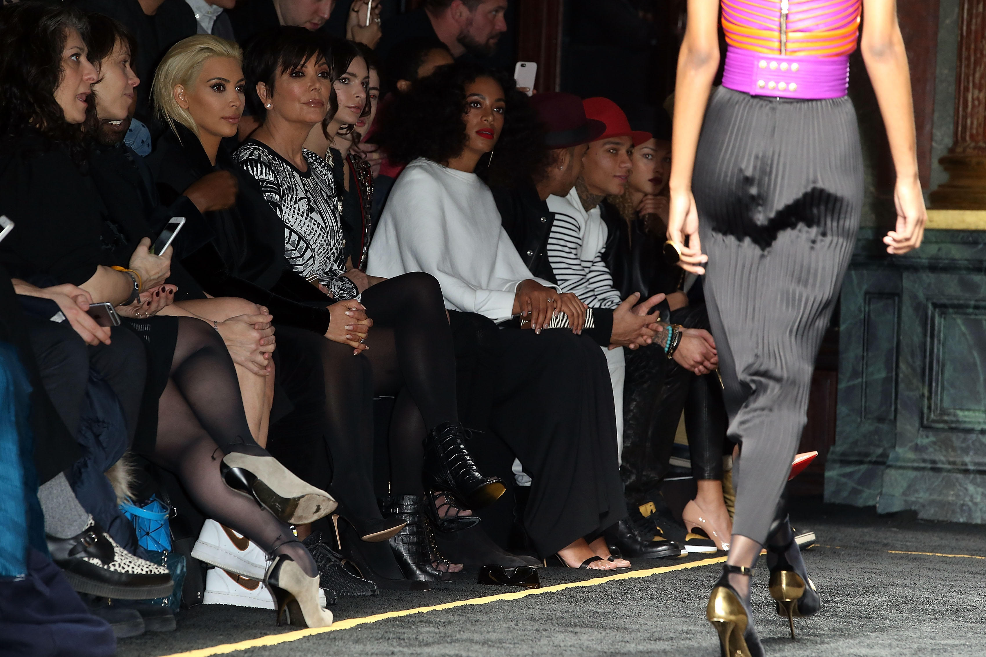 Kim Kardashian, Kris Jenner, Solange Knowles, and Kanye West attend Balmain show during Paris Fashion Week