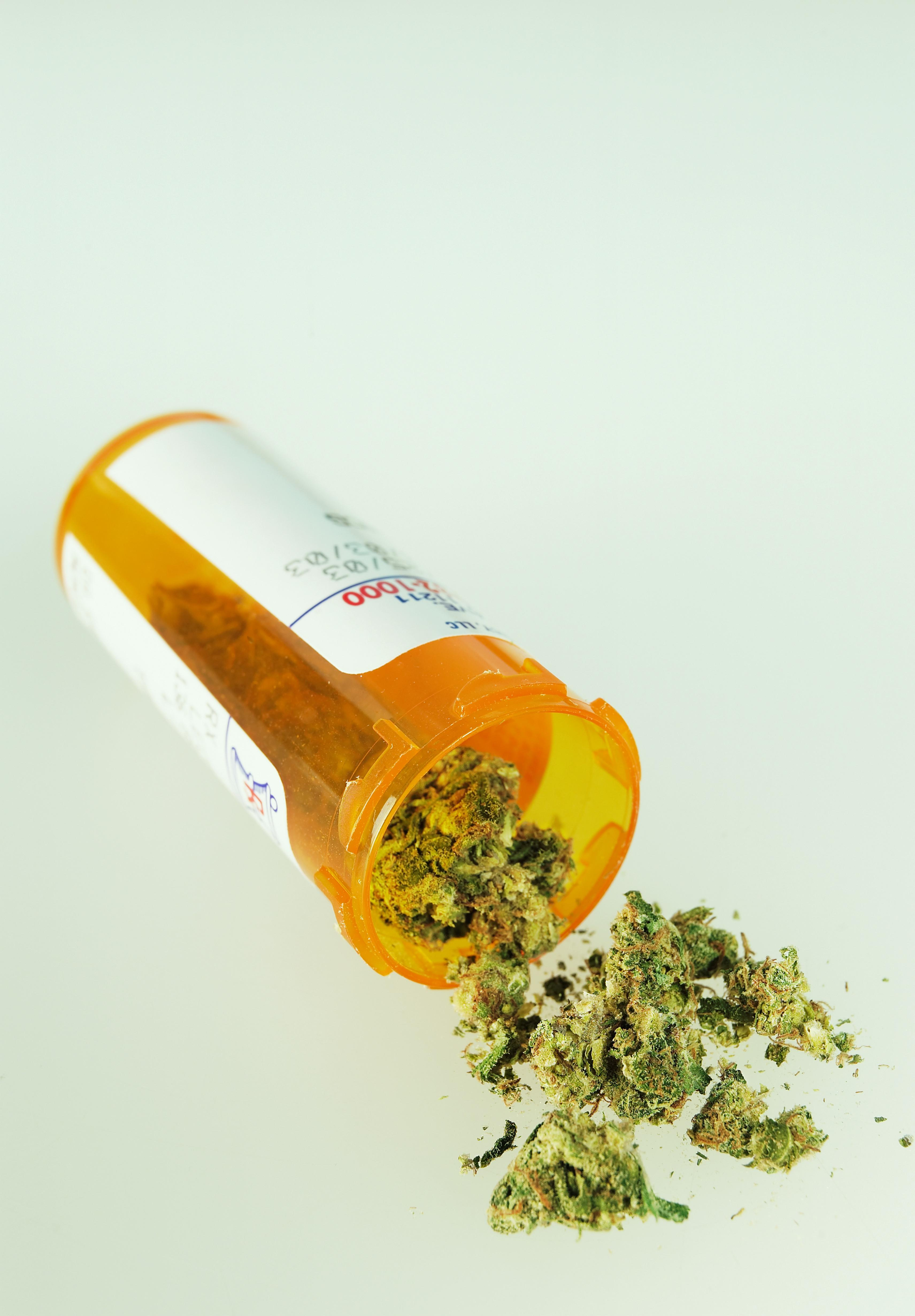 Marijuana spilling out of prescription bottle
