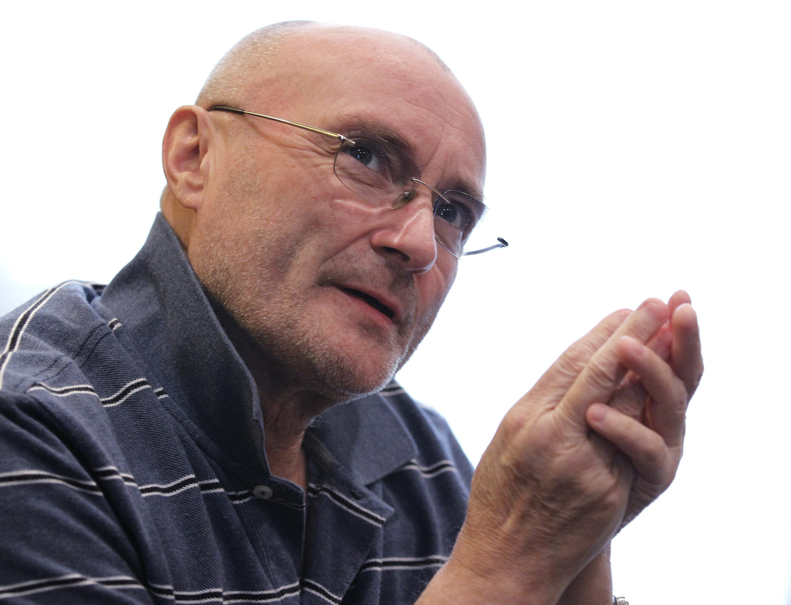 Phil Collins hospitalized after fall, postpones tour