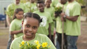 Volunteers planting flowers in playground