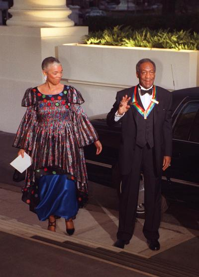 Actor and comedian Bill Cosby (R) and his wife Cam