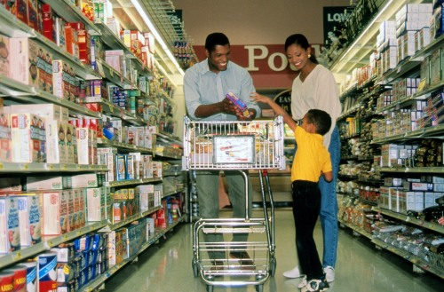 Family shopping in grocery store.