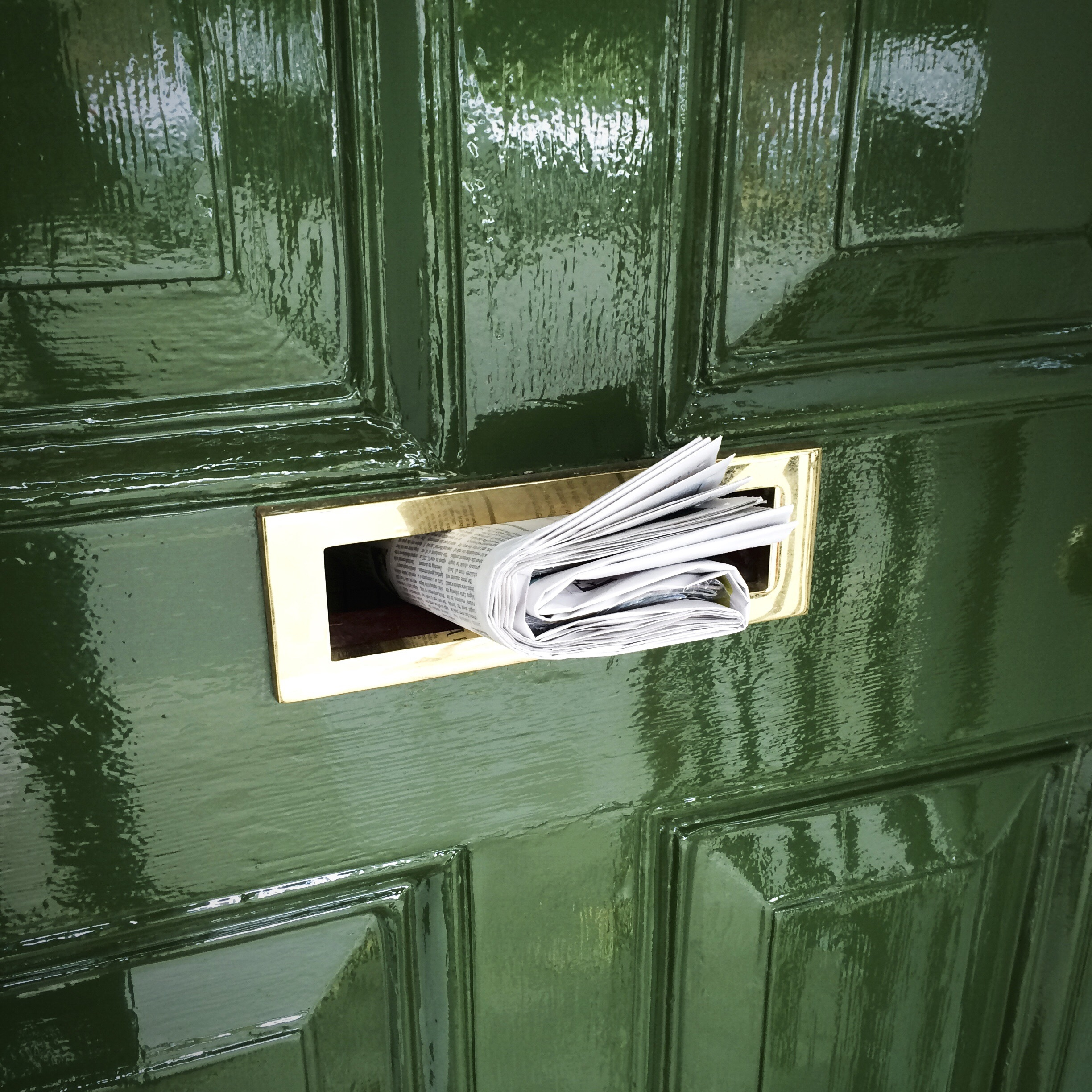 Rolled Newspaper In Mailbox