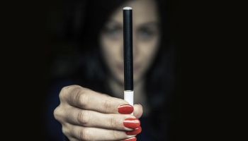 Woman holding an electronic cigarette