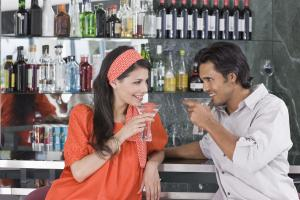 Couple having drinks at bar