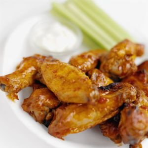Close-up of buffalo chicken wings with dip and celery