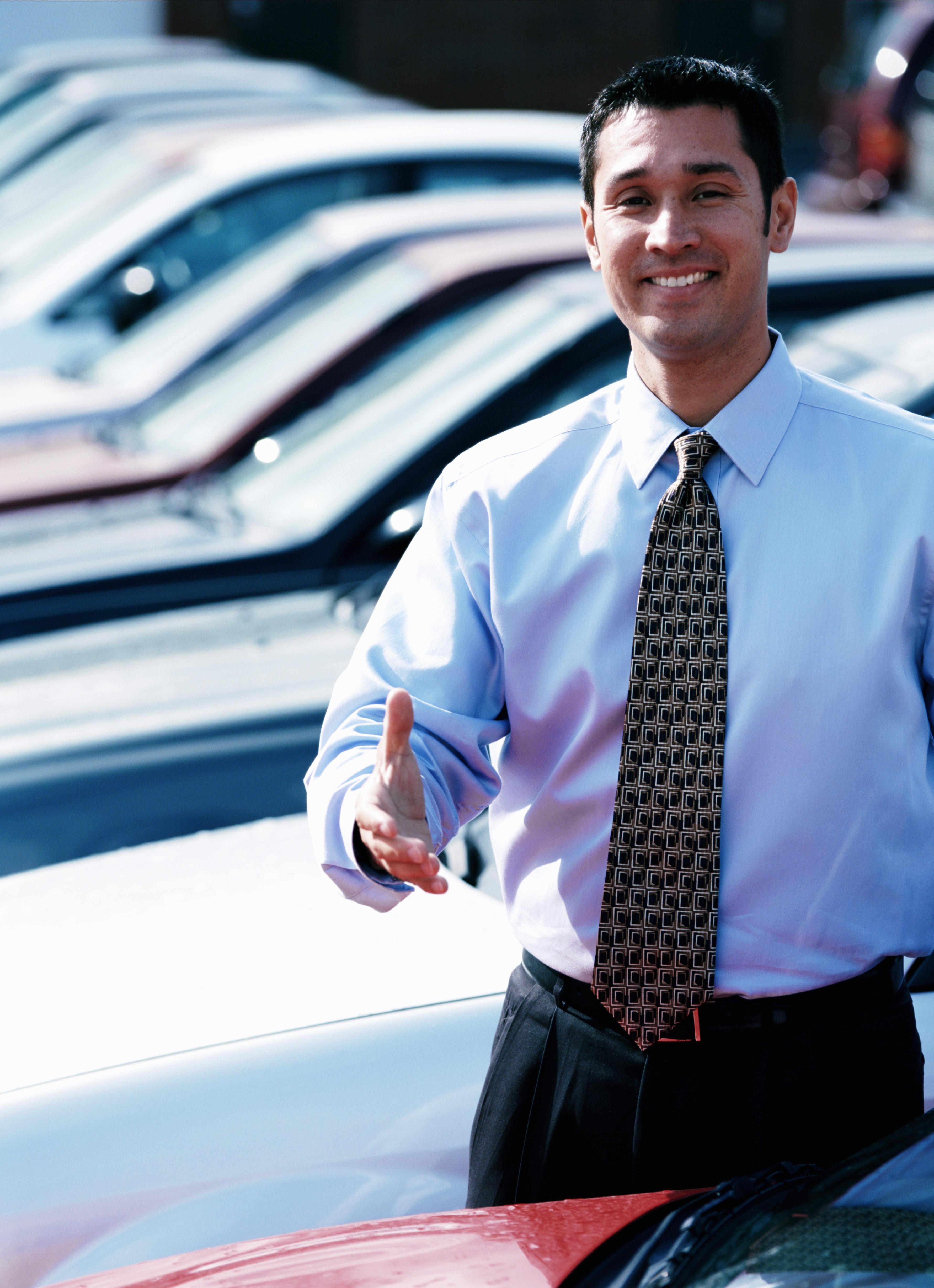 Car salesman in car lot