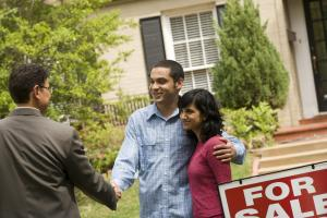Home Owners Giving a Handshake to the Real Estate Agent