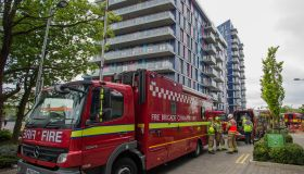 Eight fire engines and around 60 firefighters attend to a fire in a block of flats on Hatton Road, Alperton.