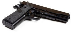 Low Angle View Of Gun Over White Background