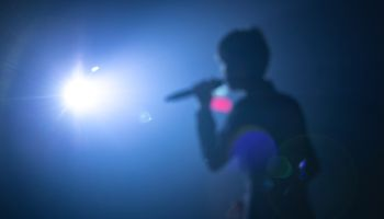 blurred background of singer on concert stage