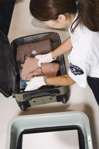 Airport security officer inspecting luggage