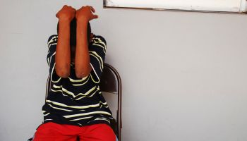 Dominica, Roseau, Juveniles Prison social center, teenager hiding his face