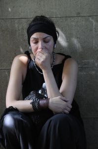 A woman mourns on July 24, 2011, as they
