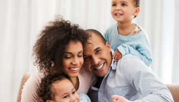 Portrait of cheerful African American family at home.