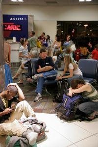 Passengers waiting for a delayed Delta Airlines flight at Hartsfield-Jackson Atlanta International Airport.
