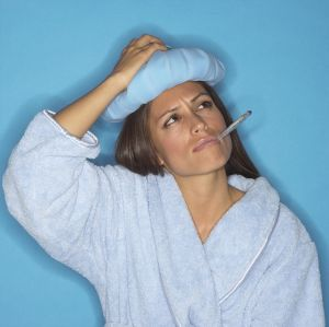 Woman with thermometer and icepack