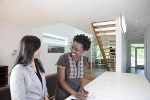 Real estate agent talking to prospective buyer