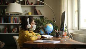 Schoolgirl watching online education class