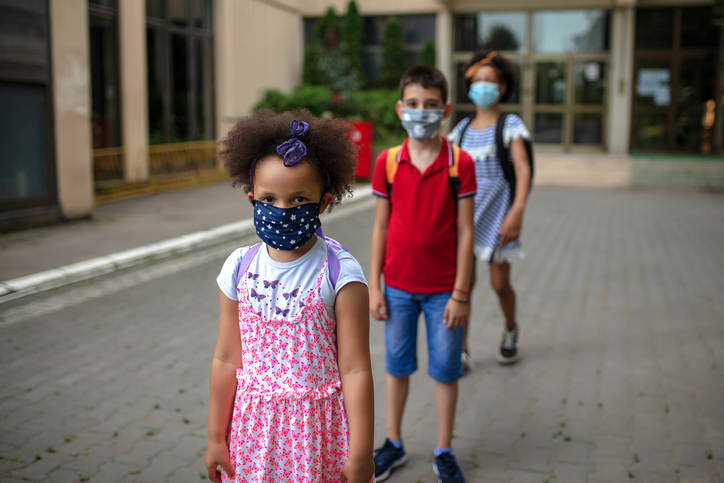Young Students on School Campus Wearing Medical Face Masks